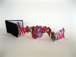 """She Sews"" is an accordion book I made as homage to my mom who made so many clothes for herself, her kids, and her kids' dolls!"