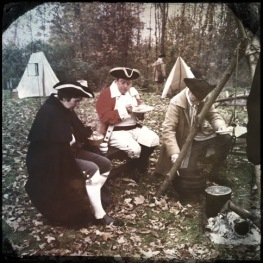 Benedict Arnold and Aaron Burr sit down to eat a proper meal before heading north to try to take Quebec