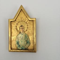 The Mechanic: 22 karat gold leaf on incised and embossed panel